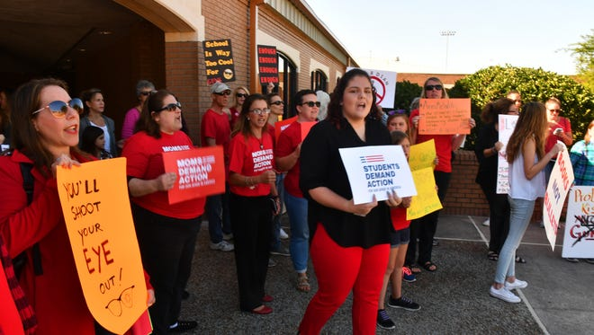 About 40 to 50 protesters were outside before a recent Brevard school board meeting, protesting arming school personnel with guns.