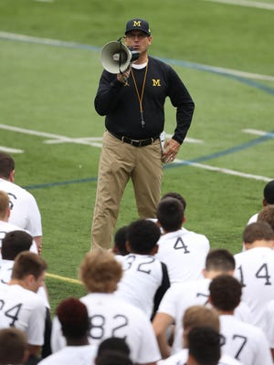 Michigan coach Jim Harbaugh talks to high school players during the Michigan Football Elite Camp on June 23, 2017, at Michigan Stadium.