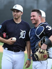 Tigers catcher James McCann, right, poses with pitcher
