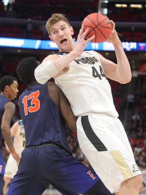 Purdue center Isaac Haas is defended by against Cal State Fullerton forward Arkim Robertson during the first half Friday at LCA.