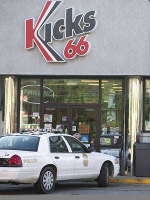Police on the scene at Kicks 66, where a clerk was shot in the head during an overnight robbery at the gas and convenience store on the west side of Indianapolis, West Troy Avenue and South Lynhurst Drive, June 5, 2014. The victim was transported to Eskenazi Hospital and is in critical condition.