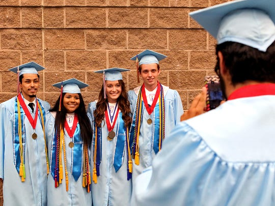 Several Hirschi graduates pose for a photo before the graduation ceremony Saturday afternoon at the Multi-Purpose Events Center.
