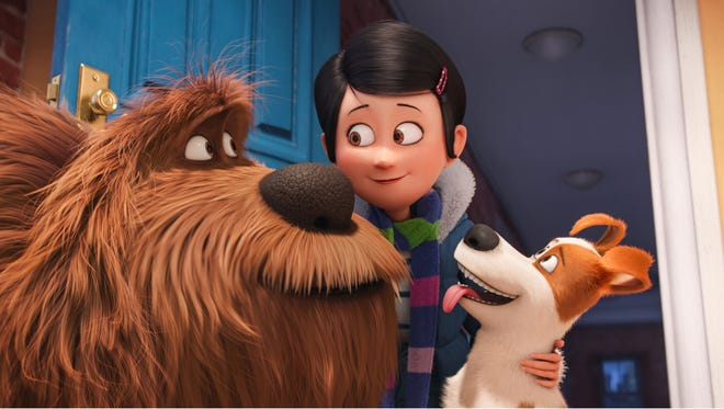 "Big mutt Duke (voiced by Eric Stonestreet), new owner Katie (Ellie Kemper) and canine roommate Max (Louis C.K.) in a scene from ""The Secret Life of Pets."""