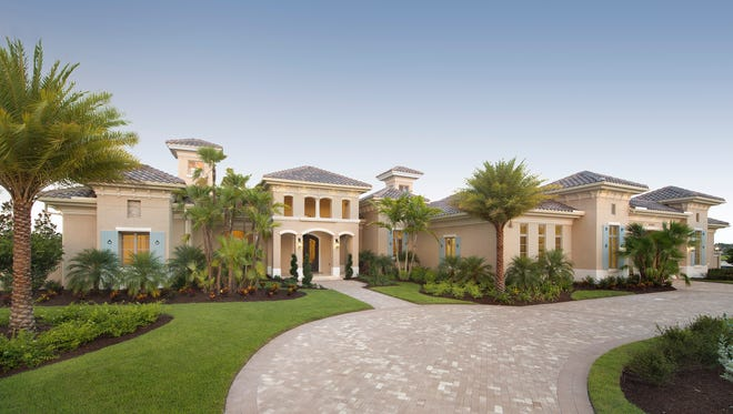 Stock Custom Homes' furnished Cristale grand estate model at Quail West is on schedule for completion in late July, priced at $3,572,930, with furnishings.