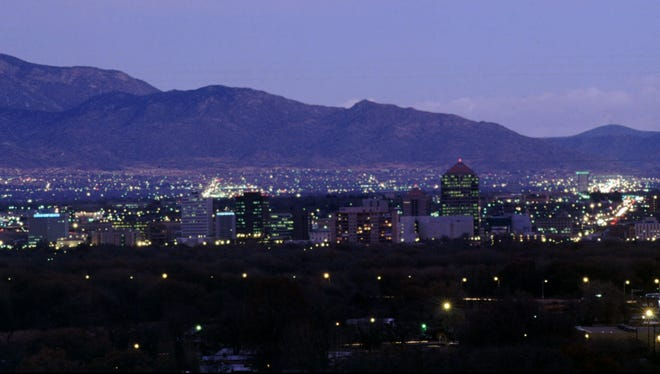 The Albuquerqu skyline lights up at dusk.