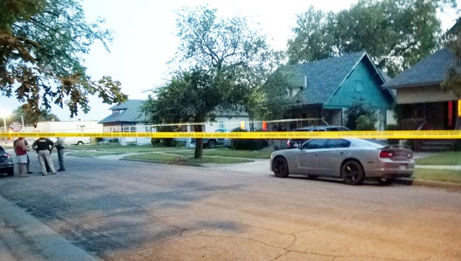Police tape surrounds a car in Wichita, Kan., on Thursday after a 10-month-old girl died after being left inside a hot car.