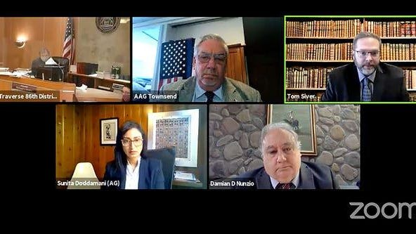 Tom Siver, top right, the attorney for Michael Null and Damian Nunzio, bottom right, the attorney for William Null speak during a bond hearing in front of Judge Michael Stepka, top left as Assistant Attorney General Sunita Doddamani and Assistant Attorney General Gregory J. Townsend via Zoom December 2, 2020.