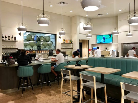 High Tide Bar & Grill opened July 17 in Whole Foods Market at Mercato in North Naples.