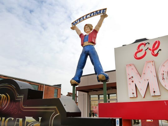 "The ""Welcome"" genie at the American Sign Museum's entrance."
