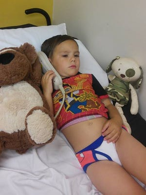 Amy Carey shared this photo of her 3-year-old son Cason in the hospital. Cason was trapped inside a hot car for 20-30 minutes before being found by his mom.
