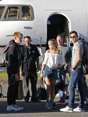 Eric Casaburi and his family exit a plane at Monmouth Jet Center in Wall Friday, after flying out of Florida to avoid Hurricane Irma.
