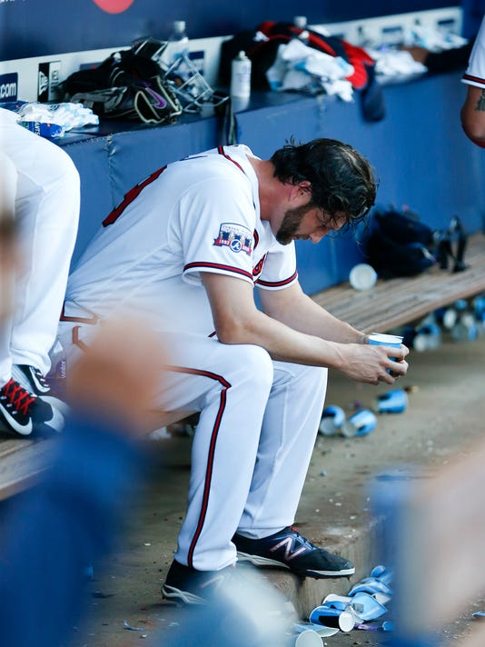 Atlanta Braves relief pitcher Jason Grilli (39) sits on the bench after blowing a save in the ninth inning of a baseball game against the Washington Nationals Monday, April 4, 2016, in Atlanta. Washington won 4-3 in ten innings. (AP Photo/John Bazemore)