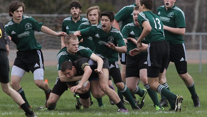 Wausau players tackle an opponent as the then Wausau Area High School Rugby Club played the Bay Area High School Rugby Club last spring in West. This year the team will be the D.C. Everest Rugby Club and will be officially sponsored by D.C. Everest High School.