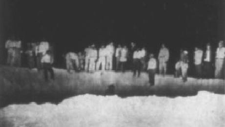 Onlookers view a crater described as about 50 feet in diameter and 24 feet deep. It was  caused by the impact of an off-course V-2 rocket in 1947.