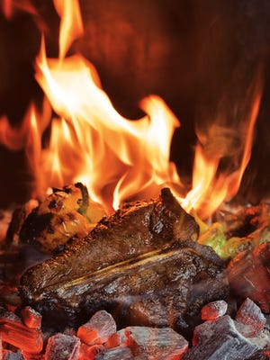 Caveman Porterhouse from Project Fire: Cutting-Edge Techniques and Sizzling Recipes from the Caveman Porterhouse to Salt Slab Brownie S'Mores by Steven Raichlen (Workman Publishing).