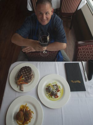 Chef Vincent Tancredi shows off some special dishes at Chubby's 1 1/2 Hearth Steakhouse in Gloucester City.