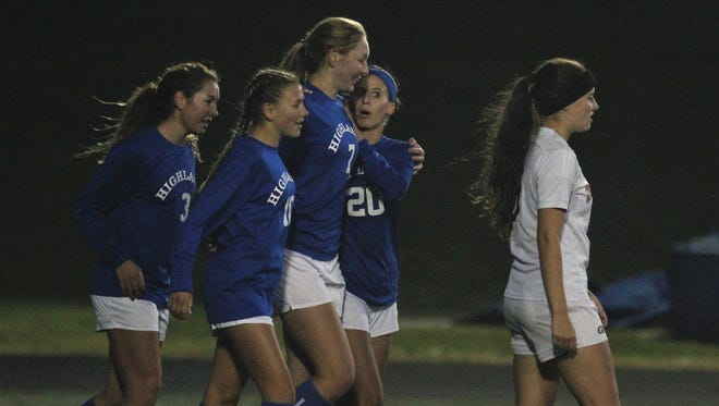 Highlands junior Lauren Deckert is hugged by junior Maria Wiefering, 20, after Deckert scored on a penalty kick during Highlands' 4-0 win over George Rogers Clark in the KHSAA girls soccer state round of 16 Oct. 22, 2018 at Tower Park, Fort Thomas KY.