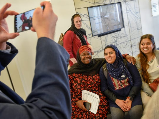 Zulfat Suara, center, sits with the other Muslim women for a photograph after the others voted early in Nashville.