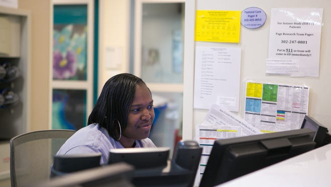 Emergency Services Clerk, Damitia Henry, works in the emergency room area of the Nemours/Alfred I duPont Hospital for Children.