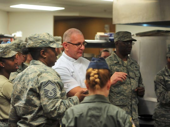 Celebrity Chef Robert Irvine talks with spectators as he oversees an Air Force cooking competition between cooks from Malmstrom, F.E. Warren, and Minot Air Force Bases on Thursday morning in the Grizzly Bend kitchen at Malmstrom.