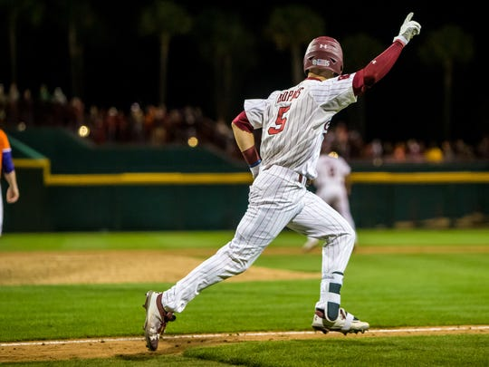 South Carolina Gamecocks center fielder TJ Hopkins (5) celebrates his game-winning walk-off sacrifice fly to defeat Clemson 3-2 at Founders Park.