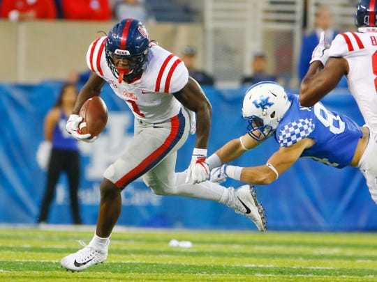 Ole Miss Rebels wide receiver A.J. Brown (1) runs the ball against Kentucky Wildcats defensive end T.J. Carter (90) on Nov. 4, 2017.