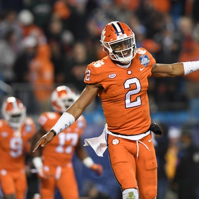 Clemson quarterback Kelly Bryant (2) reacts after throwing