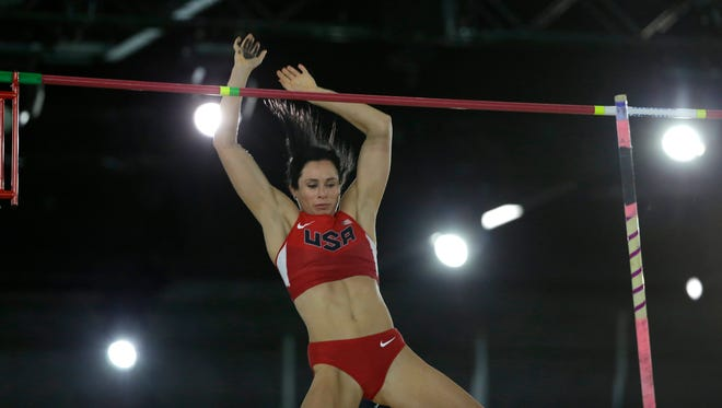 United States' Jennifer Suhr clears the bar as she competes in the women's pole vault final, Thursday, March 17, 2016, at the World Indoor Athletics Championships in Portland, Ore. (AP Photo/Elaine Thompson)