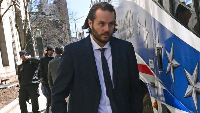 Ex-Goldman Sachs trader Matthew Taylor leaves Manhattan federal court in New York in April 2013.