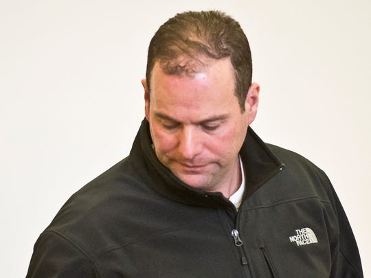 Burlington Police Officer Nathan Harvey, 45, of Swanton appears in Vermont Superior Court in St. Albans Thursday morning, pleading not guilty to domestic-assault charges.