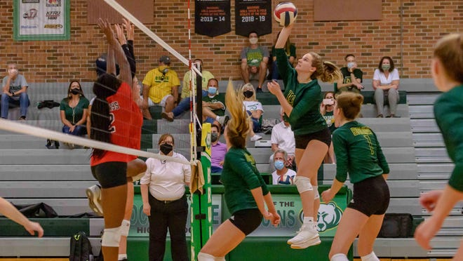 Rock Bridge's Emma Roush (10) goes up for a spike during a match against Jefferson City on Tuesday night at Rock Bridge High School.