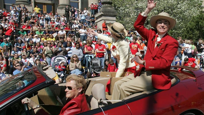 Gregory Geoffroy, then Iowa State University's president, rides in the Veishea parade with his wife, Kathy, in 2006.