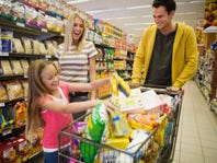 Family shopping at supermarket