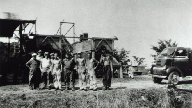 German prisoners of war gather for a photo at Appleton's Fuhremann Canning Co., which hosted one of two Outagamie County POW camps in the summer of 1945.