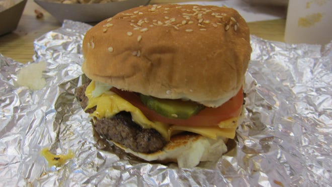 """A """"little"""" cheeseburger at Five Guys, just one patty with several of the 15 available toppings."""