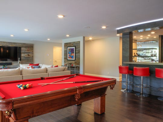The bar area on the lower level includes a professional-grade bar sink and custom bar and wine cellar designed by Gaetano Abate.