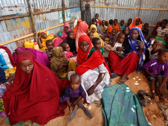 FILE - In this Saturday, Feb. 18, 2017 file photo, displaced Somalis who fled the drought in southern Somalia sit in a camp in the capital Mogadishu, Somalia. Somalia's prime minister said Saturday, March 4, 2017 that 110 people have died from hunger in the past 48 hours in a single region as a severe drought threatens millions of people.
