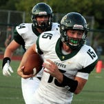 Senior tight end Drew Sheckell (88) hauls in this 32-yard second-quarter pass which led to Groves' first touchdown Thursday at West Bloomfield.