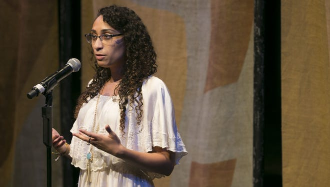 """Melissa Dunmore tells her story at Arizona Storytellers """"Estamos Aqui/We Are Here"""" at South Mountain Community College Performing Arts Center in Phoenix, Ariz. on Thursday, March 31, 2016."""
