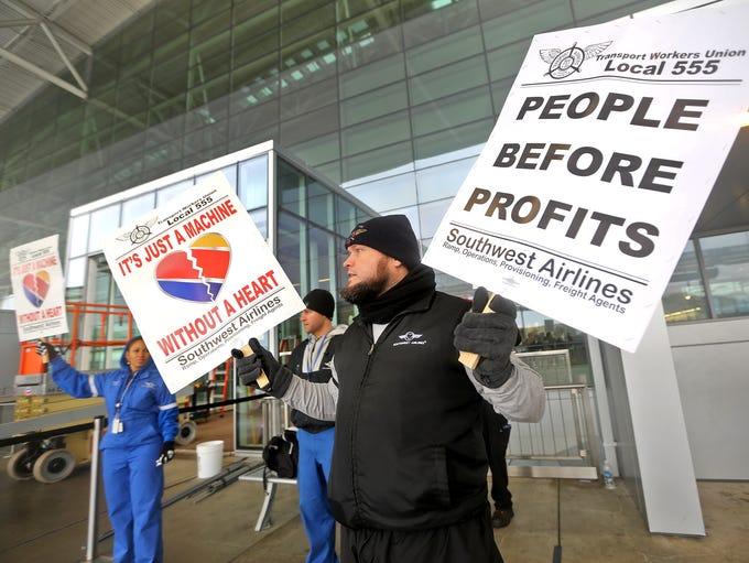 TWU 555 Indianapolis representative Shaun Burris protests