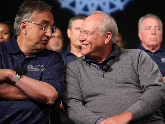 Fiat Chrysler CEO Sergio Marchionne, left, talks with UAW President Dennis Williams, during an event to mark the ceremonial beginning of its contract talks  at the UAW-Chrysler National Training Center in Detroit on Tuesday, July 14, 2015.