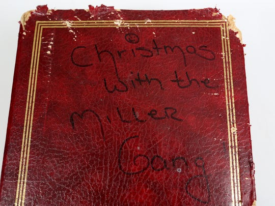 Terry Miller keeps her family Santa pictures in this album, which survived six children, eight grandchildren and being chewed up by a bulldog.