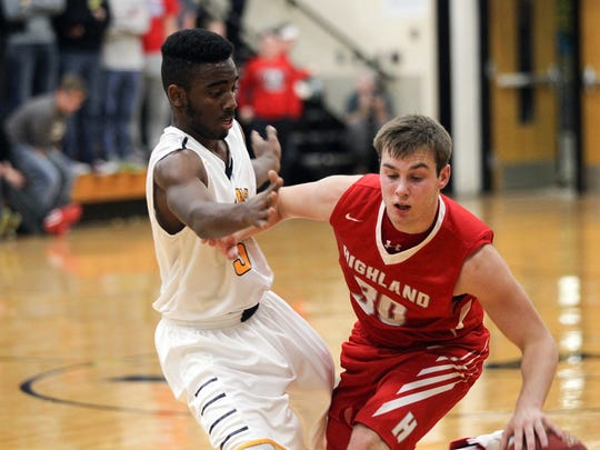 Lone Tree's Jovonte Squiers guards Highland's Trent