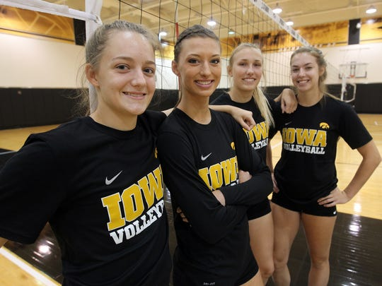 Four of Iowa's outside hitters, from left, Reagan Davey, Kasey Reuter, Cali Hoye and Meghan Buzzerio pose for a photo at volleyball media day at Carver-Hawkeye Arena on Friday, Aug. 19, 2016.