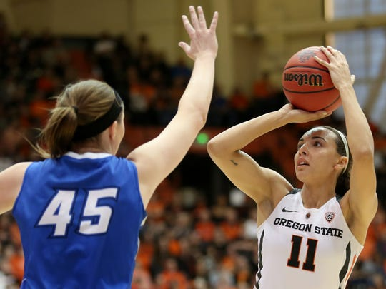 Oregon State's Gabriella Hanson (11) shoots the ball past Creighton's Audrey Faber (45) in the Creighton vs. Oregon State women's basketball game in the second round of the NCAA Division I Championship in Corvallis, Ore., on Sunday, March 19, 2017.