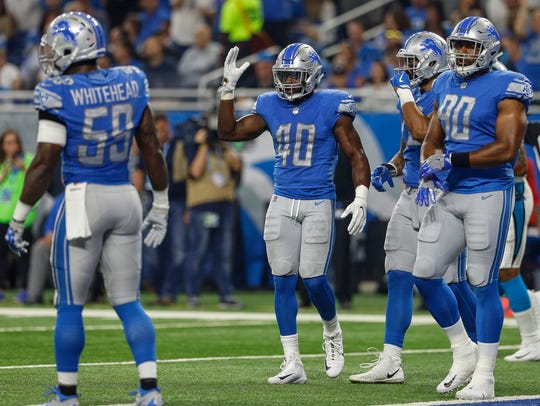 Lions' Jarrad Davis (40) in the first half of the Lions'