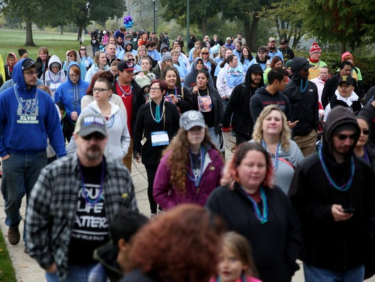 Thousands walk in the Out of the Darkness walk for
