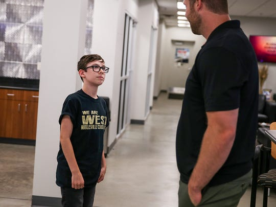 Chanden Meisenholder, a middle school student at Noblesville West Middle School, thanks Jason Seaman, the teacher who intervened to help stop the recent school shooting, at Napleton Hyundai of Carmel, in Carmel, Ind., Wednesday, June 13, 2018. Meisenholder, who was in the classroom below Seaman's during the shooting, came to say thank you as Seaman and his wife Colette received a car from dealership.