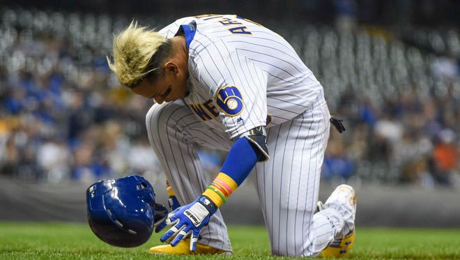 Brewers shortstop Orlando Arcia takes a knee after injuring his right ankle Friday night.