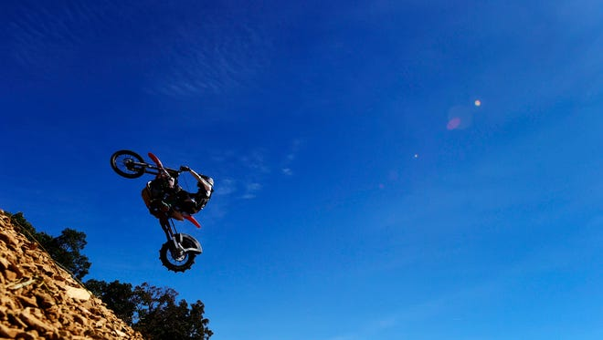 John Koester flies through the air before landing and continuing to climb during the AMA Pro Hill Climb at the White Rose Motorcycle Club in Jefferson Sunday, September 25, 2016. Koster placed first in the unlimited class during Sunday's ride. Riders get two shots at the hill with the best time counting.